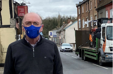Robert Spivey in street wearing mask